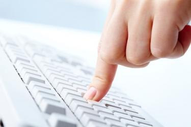 Visuel d'un clavier et d'un doigt